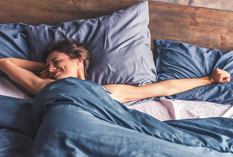 Woman smiling after sinful lucid dream