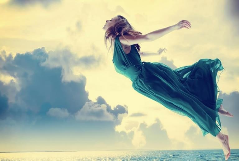 Woman flying in lucid dream feeling free