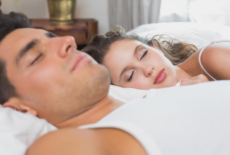 Couple sleeping and sharing a dream