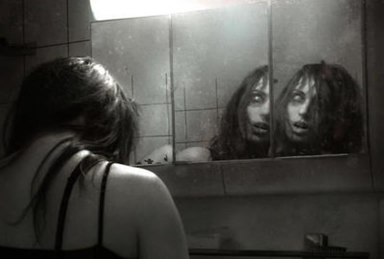 woman looking in lucid dream mirror scary